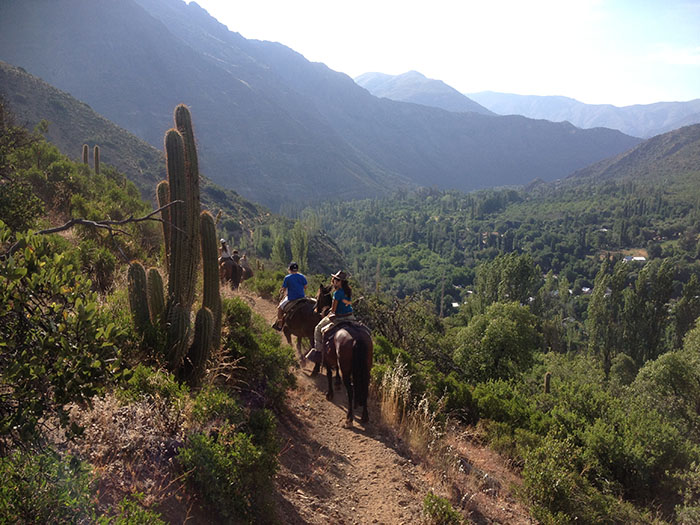Horse Riding, Central Andes Range A north american family is enjoying a horse riding through the Andes landscapes. With strong and well cared horses they are being guided by professional guides. After the horse riding they will make a funny zip line.