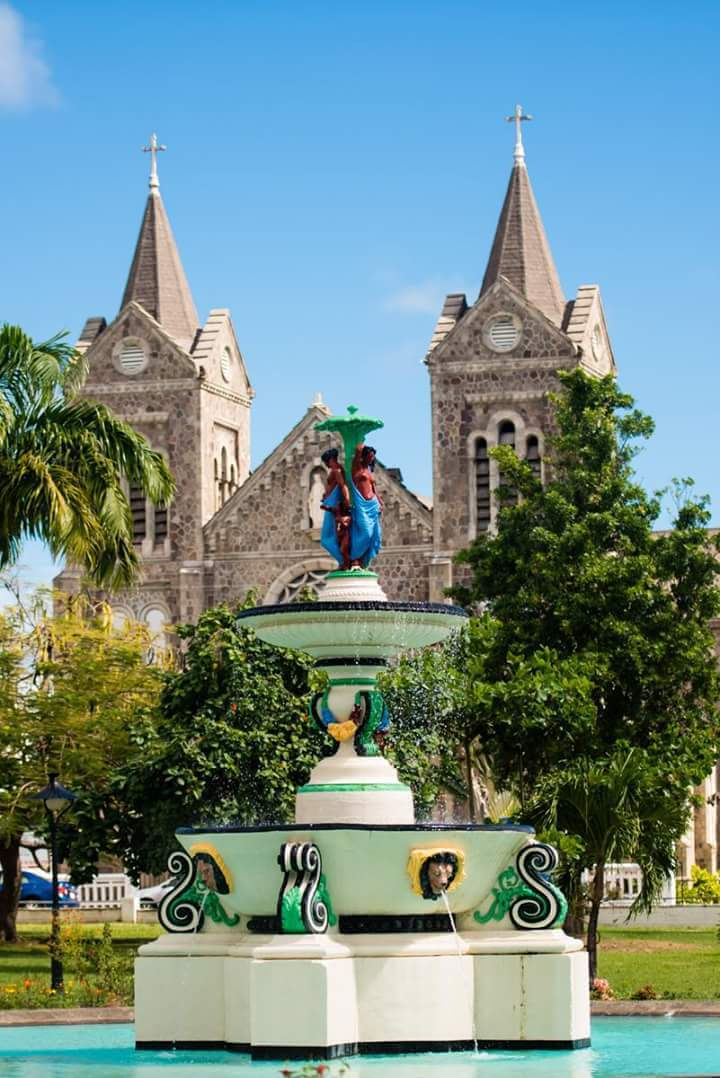 Independence square and the roman catholic church. The square was a former slave marked and the church was the first french church on the island and was originally built in 1709.