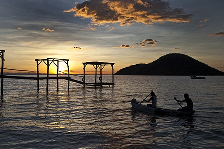 Cape Maclear sunset with fishermen, Malawi