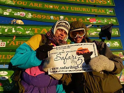 OUR HAPPY CLIENTS ON TOP OF MT KILIMANJARO SUMMIT 5895M