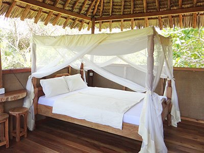 Open air Bush Bandas give you the feel of sleeping under the stars but with all the comfort you need on vacation