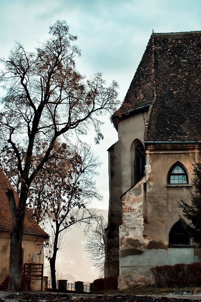 Foggy morning landscape in Sighisoara citadel , Romania